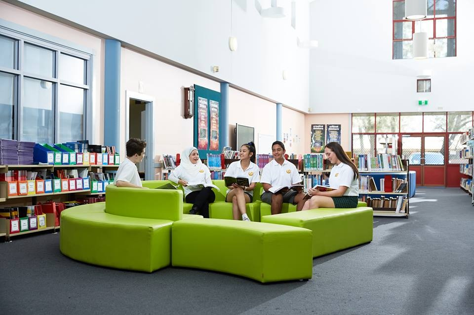 Students sitting in the library, talking