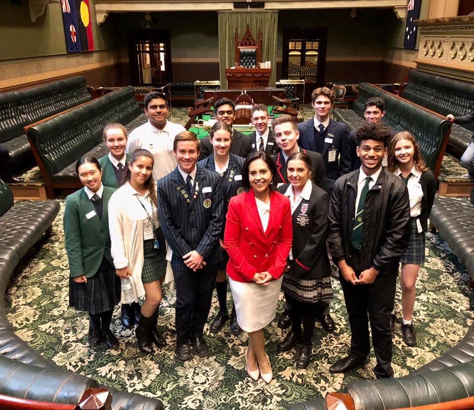 Ms Prue Car and students in the Legislative Assembly chamber